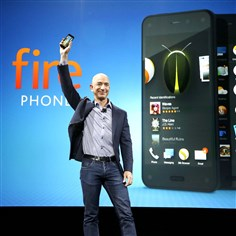 Amazon Smartphone Amazon CEO Jeff Bezos holds up the new Amazon Fire Phone at a launch event in Seattle.