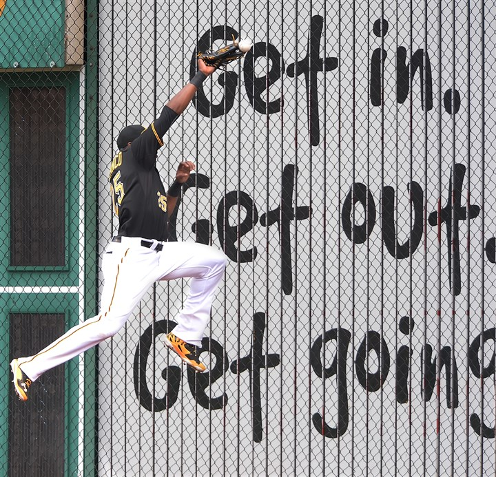 20140619pdPiratesSports01 Pittsburgh Pirates right fielder Gregory Polanco leaps for ball as it hits his glove but drops to the wall hit by the Reds Joey Votto June 9 at PNC Park Pittsburgh PA.