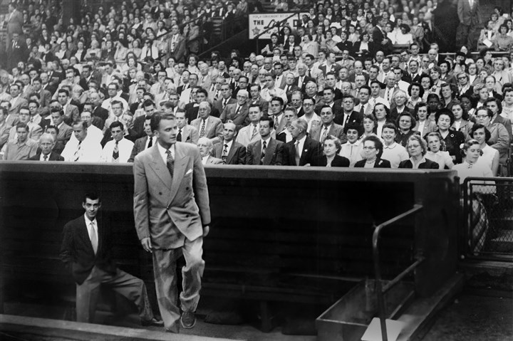 bGraham56 Billy Graham emerges from the Pirates' dugout at Forbes Field to deliver a sermon in his first visit in September 1952.