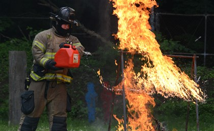 City of Pittsburgh Firefighter Joe Garrison City of Pittsburgh Firefighter Joe Garrison, of Engine 15 in Lincoln / Lemington, shows the danger of gasoline-ignited flames during the demonstration at the Pittsburgh Firing Range.