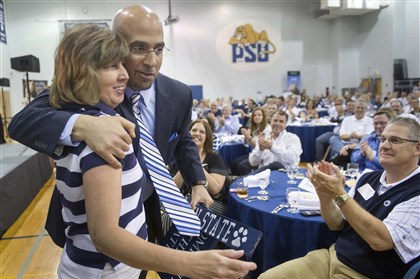 coachCaravan4 Penn State Football coach James Franklin hugs Karen Miller, of West York, after she presented him with handmade Penn State signs after his speech at Penn State York Tuesday May, 6, 2014 in the Penn State Coaches Caravan. Paul Kuehnel - Daily Record/Sunday News