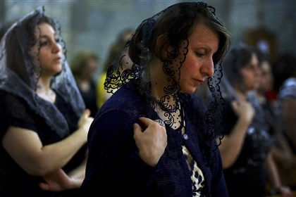 APTOPIX Mideast Iraq Fleeing Christians Iraqis attend Mass at the Chaldean Church of the Virgin Mary of the Harvest in a 7th-century monastery overlooking Alqosh, Iraq. Dozens of Christians have fled to this Kurdish-controlled village from Mosul, which has been overtaken by Islamist extremists.