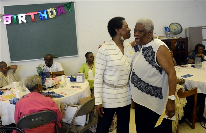 Grace Dixon-Kizzle and Hazel Jackson Grace Dixon-Kizzle, left, executive director of Lemington Community Services, greets, Hazel Jackson, 73, of Wilkinsburg in the last birthday bash at Cornerstone Baptist Church on Friday in Lemington. The program will be closed on June 31 because of lack of funding.