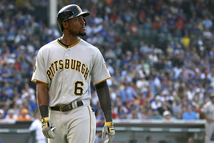 Pirates Cubs Baseball Representing the tying run, the Pirates' Starling Marte looks back out into right field after his long fly ball was caught by Cubs right fielder Nate Schierholtz, near the warning track during the seventh inning of today's game at Wrigley Field in Chicago.