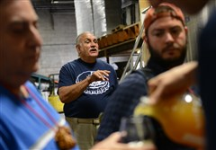 In this 2014 image, Tom Labanc shares his knowledge of beer as a tourguide with Pittsburgh Brew Tours on a stop at the East End Brewing Company in Homewood.