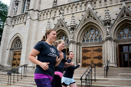 20140621lfRunMagazine01-10 Minnesota native Trista Yerks, left, founder of Pittsburgh Running Tours, leads Sarah Doherty, center, of Hampton and Ivy Steinberg of South Side on a running tour past St. Paul Cathedral in Oakland. Trista Yerks started in 2013 as an active way for visitors (and locals) to explore the city at a comfortable jogging pace.