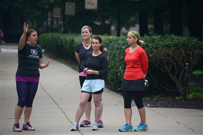 20140621lfRunMagazine02-1 Minnesota native Trista Yerks, left, founder of Pittsburgh Running Tours, gives a tour to Sarah Doherty, second from left, of Hampton, Ivy Steinberg and Georgeann Tamburo, both of South Side during a running tour in Oakland. Ms. Yerks started in 2013 as an active way for visitors (and locals) to explore the city at a comfortable jogging pace.