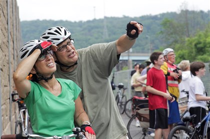20140621ttEaglesLocal (2)-17 Mark Bookman of the Strip District points out the eagles in Hays to his wife, Marsha, as they watch with other viewers Saturday on the Great Allegheny Passage bike trail.