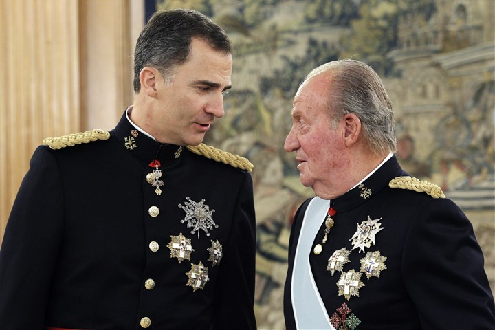 Spain Abdication Spain's newly crowned King Felipe VI talks with his father, Juan Carlos, who stepped down as king this week after nearly four decades on the throne.