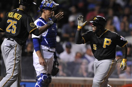 Pirates Cubs Baseball The Pirates' Josh Harrison (5) celebrates with teammate Gregory Polanco (25) at home plate after hitting a two-run home run during the seventh inning against the Chicago Cubs in Chicago on Saturday.
