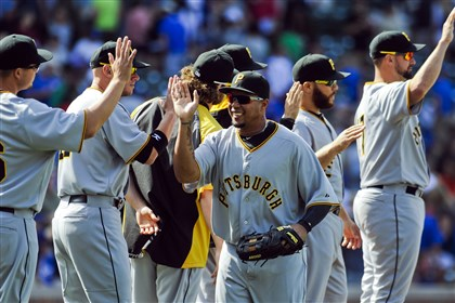 Pirates Cubs Baseball.JPEG-.18-1 Right fielder Jose Tabata celebrates with teammates after the Pirates defeated the Chicago Cubs 2-1, in Chicago.