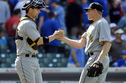 Pirates Cubs Baseball.JPEG-.20-2 Mark Melancon, right, and catcher Chris Stewart congratulate each other after the Pirates won, 2-1.
