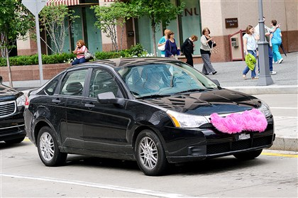 20140622lrlyftlocal01-12 A car sporting the Lyft mustache on its grill is seen Downtown. A unanimous vote by the Pennsylvania Public Utility Commission board Thursday granted emergency temporary authority for ride-sharing companies Lyft and Uber to operate in Allegheny County.