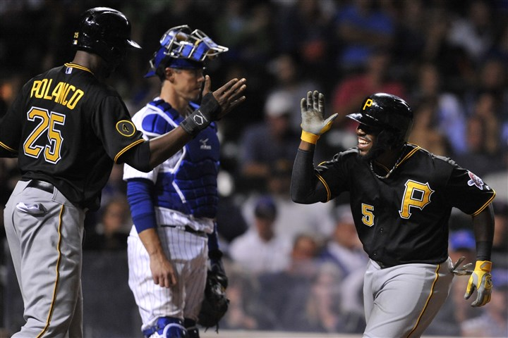 Pirates Cubs Baseball The spectacular season of the Pirates' Josh Harrison, shown here celebrating with teammate Gregory Polanco after hitting a two-run home run during a game against the Cubs in Chicago earlier this year, continues as he heads to his hometown of Cincinnati as an All-Star.