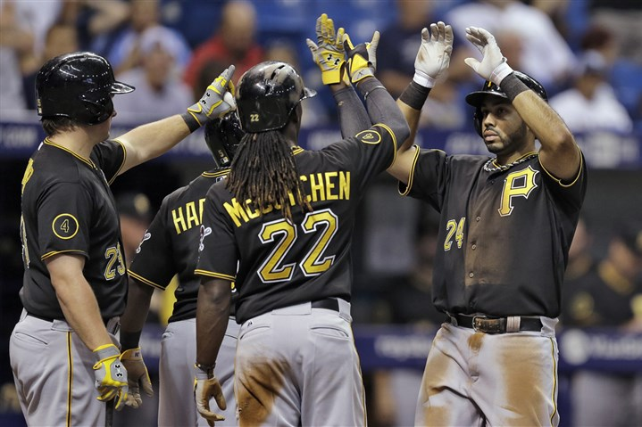 Pedro Alvarez high fives teammates Pedro Alvarez high fives teammates, including Andrew McCutchen, Travis Snider and Josh Harrison after hitting a three-run home run off Tampa Bay Rays starting pitcher Alex Cobb during the third inning.