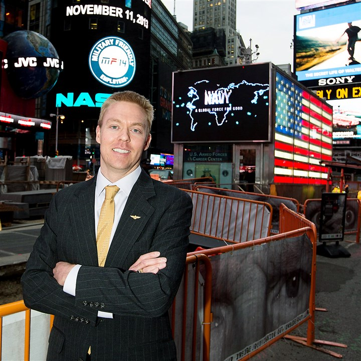 20140623homilitary0624biz Sean Collins, VP Product Development at Victory Media, at Nasdaq in NYC.