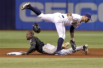 bucs0625c-1 Pirates' Starling Marte is caught stealing second base by Tampa Bay Rays second baseman Sean Rodriguez during the fifth inning.