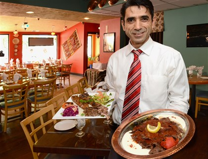 20140624radIstanbulSofraMag01 Owner Adnan Pehlivan offers Lamb Kabob (left) and Iskender Kabob at his Istanbul Sofra restaurant at Forbes and South Braddock avenues in Regent Square.