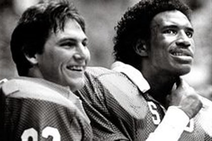 smu0625 Former SMU running backs Craig James, left, and Eric Dickerson, right, starred for the program that became the poster child for NCAA violations in the 1980s.
