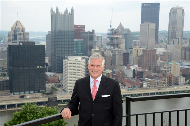 20140624lfTourMagazine02-1 Craig Davis, CEO of Visit Pittsburgh, poses at the overlook on Grandview Avenue on Mount Washington.