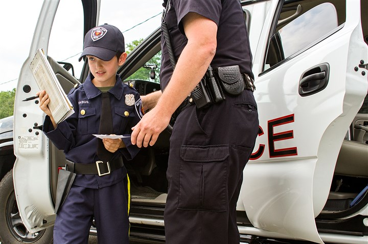 Joey Fabus Make a Wish Joey Fabus, 8 of Bethel Park, exits a Bethel Park cop car with officer Tom Rigatti to write a traffic citation Tuesday. Joey has an inoperable brain tumor, and his wish of becoming a police officer was granted for a day. He was given a uniform, sworn in and wrote a citation.