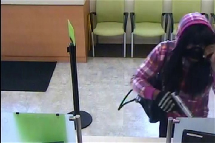 062414_carricksuspect.jpg A surveillance camera captured images of the suspect in a Carrick bank robbery.