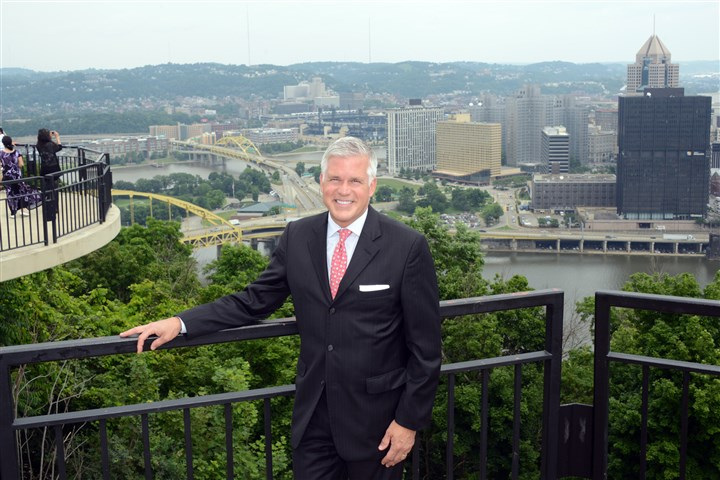 20140624lfTourMagazine01 Craig Davis, CEO of Visit Pittsburgh, poses at the overlook on Grandview Avenue on Mount Washington.