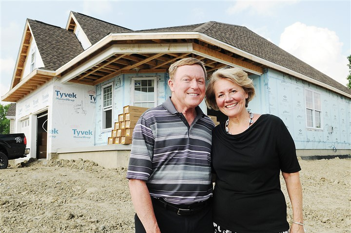 Restricted housing growing in popularity John and Judy Woffington outside their future home in a Traditions of America housing development in Ohio Township. The Philadelphia-based developer is building their second age-restricted community in Pittsburgh. The communities aim to attract active retired people 55 years of age and older.