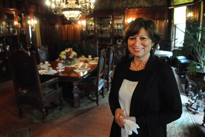 20140706CMTourFrickSunMag001 Jamie Blatter, docent for the Clayton House of the greater Frick Museum, poses in the dining room of the Clayton House.
