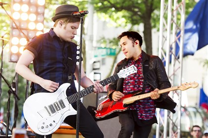 20140628FallOutBoy1 Fall Out Boy members Patrick Stump, left, and Pete Wentz perform.