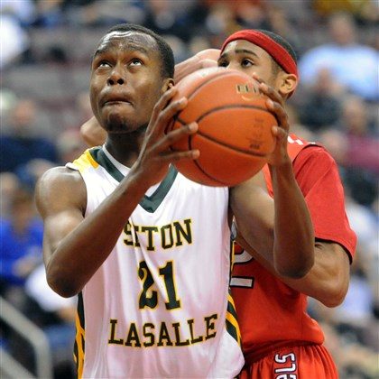 9nx00kob.jpg Seton-LaSalle's Levi Masua, 21, will play college basketball at Pitt-Johnstown with former Rebels teammate Dale Clancy.