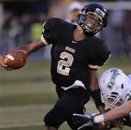 9j700ksj.jpg Quaker Valley quarterback Dane Jackson attends Cornell High School but competes for the Quakers under a PIAA-approved cooperative agreement.