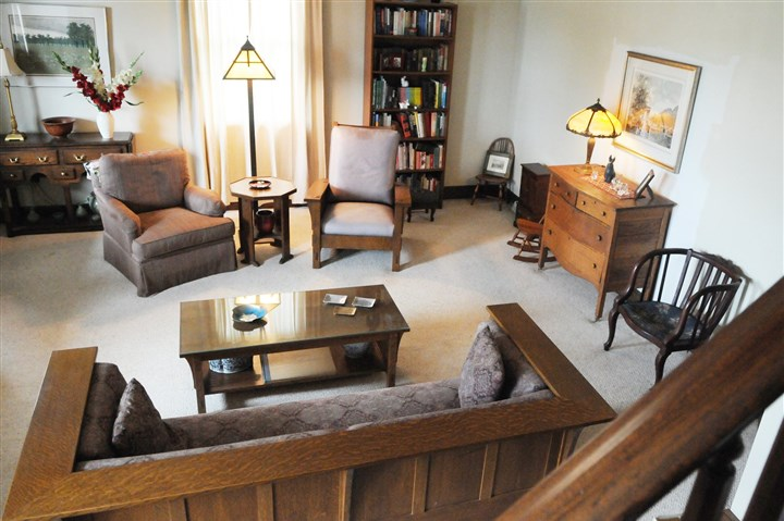 The living room is sunny with neutral carpeting. The living room is sunny with neutral carpeting.
