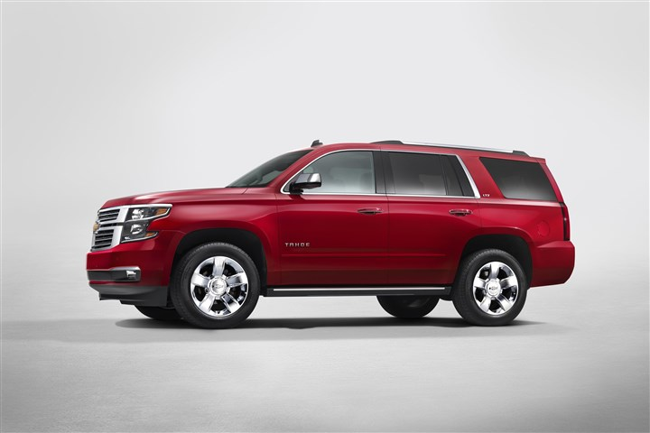 2015 Chevrolet Tahoe in Crystal Claret side view from New York R 2015 Chevrolet Tahoe in Crystal Claret side view from New York reveal showcases Tahoe's all new design.