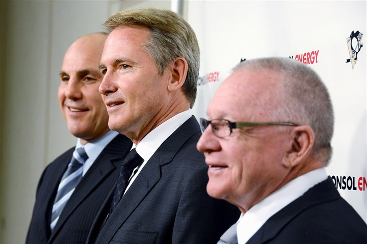 New Pens coach Mike Johnston  New Penguins head coach Mike Johnston, center, poses for a picture with new assistant coach Rick Tocchet, left, and Penguins general manager Jim Rutherford.