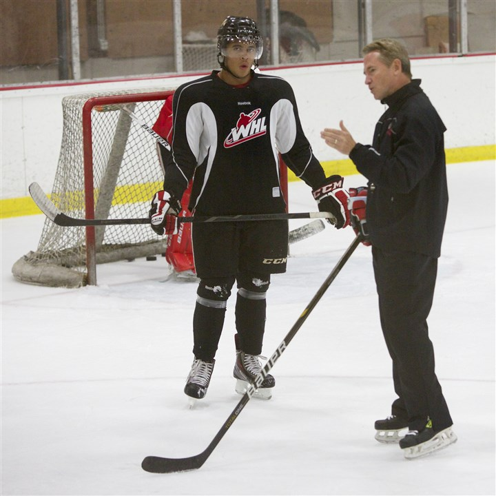 johnston4-1 New Penguins head coach Mike Johnston, is shown here talking to one of his former players, Keegan Iverson, during practice with the Portland Winterhawks on Sept. 3, 2013.