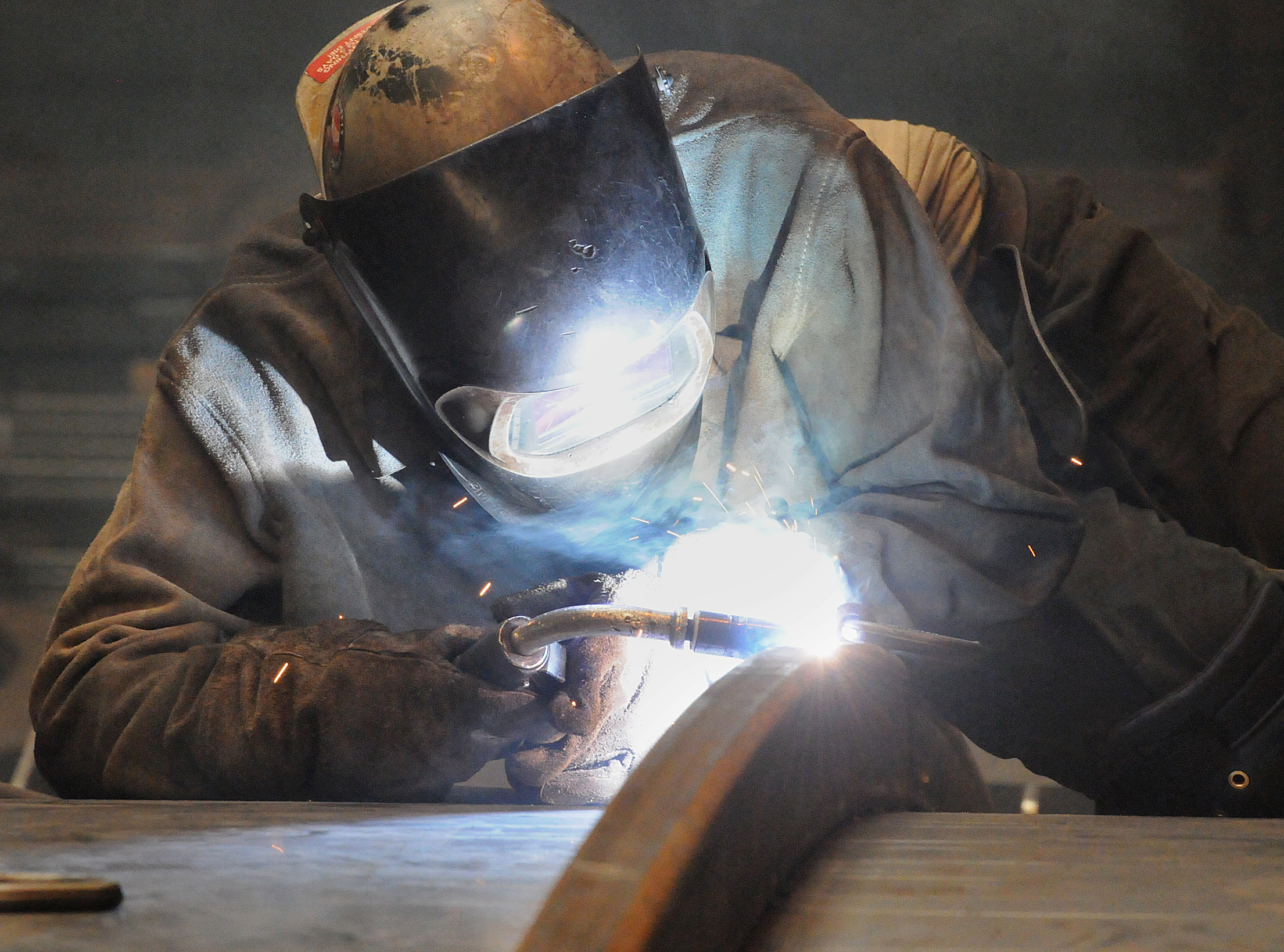20140625radETCJohnstownBiz11-10 An ETC welder wears protective gear as he works on a piece of equipment. The company manufactures frack tanks, sand separators and other midstream drilling instruments.