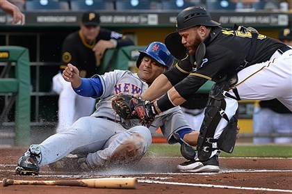 20140626pdPiratesSports01 Pirates catcher Russell Martin tags out Mets' Bobby Abreu at PNC Park.