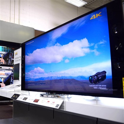 20140626MWHbestbuyBusiness01 The 4k Ultra HD television is displayed inside Best Buy's Robinson location in June.