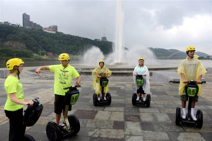 20140625MWHsegwayMag03-2 Segway In Paradise guides Sara Harper, far left, and Alan Harper, to her immediate right, who are siblings, lead a tour through Point State Park.