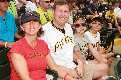 Neil Alexander with his wife, Suzanne, and children, Abby and Patrick Neil Alexander with his wife, Suzanne, and children, Abby and Patrick, during a Pirates vs. Yankees spring training game March 17, 2013, in Bradenton, Florida.