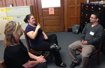 Christopher Bennett and interpreters Christopher Bennett, right, a deaf juror who sat on a criminal trial this week, sits in the Allegheny County COurthouse Friday with interpreters Pamela Replogle, left, and Tracy Cummins.