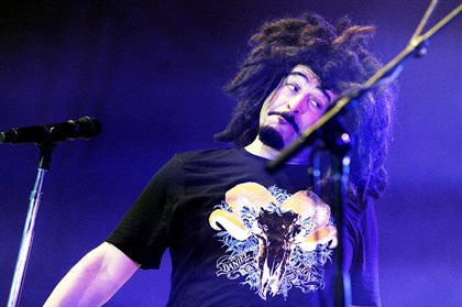 Lead singer Adam Duritz Lead singer Adam Duritz performs with the Counting Crows outdoors at Stage AE on the North Shore last month. The band's ballads were drowned out by chatter from the audience.