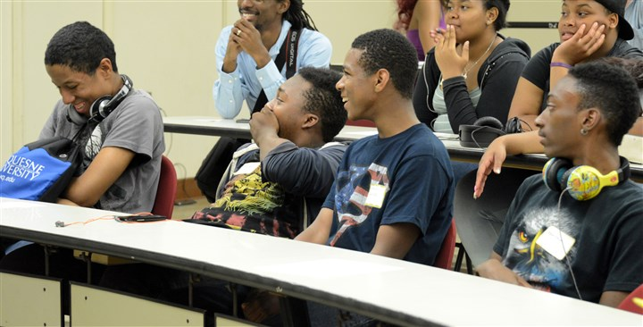 "Homewood students Sitting in the front row, from the left, Joel Adams, 18, Tavon Price, 14, Lemuel Jackson, 18, Montana Howard, 16, all from Homewood, share a laugh with other students during Terrance Hudson's ""Becoming a teacher leader"" workshop."