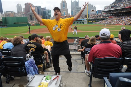 "20140706rldHotDog07-6 Hot dog vendor David Sakulsky, nicknamed ""Chico,"" tries to pump up the crowd during an afternoon Pirates game against the Cincinnati Reds at PNC Park."