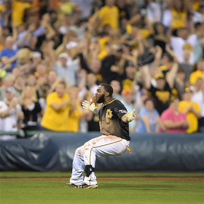 harrison0630 Josh Harrison celebrates after driving in the winning run for the Pirates Friday night to beat the Mets.