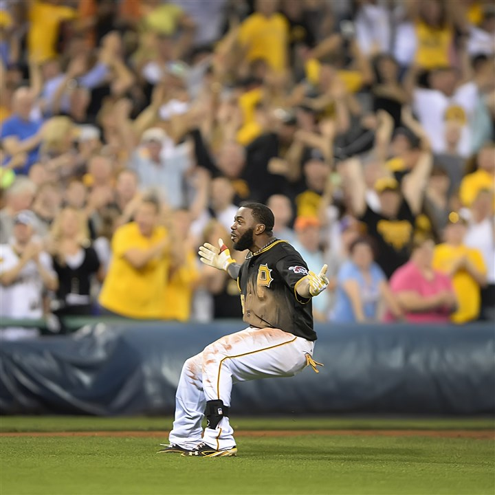 20140627pdPiratesSports05-1 Pittsburgh Pirates Josh Harrison celebrates after hitting the game winner against the Mets in the 11th inning June 27 at PNC Park.