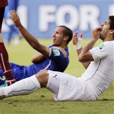 Brazil WCup Luis Suarez Uruguay's Luis Suarez holds his teeth after biting Italy's Giorgio Chiellini's shoulder during the group D World Cup soccer match Tuesday. On Thursday, FIFA banned Suarez for 9 games and 4 months for biting his opponent at the World Cup.