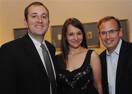 FrickDegas  Brian and Abby Dobias, with Mark Turcsanyi.