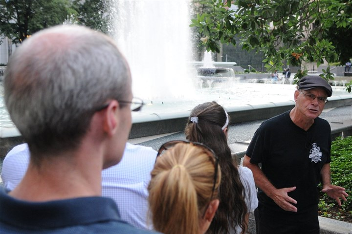 20140627DARtourLocal01 Local guide Haydn Thomas, of Pittsburgh Haunted Tours, shares a ghost story with guests on a recent tour. Here, he stands in Mellon Square and tells them about the history of the Penn Hotel.